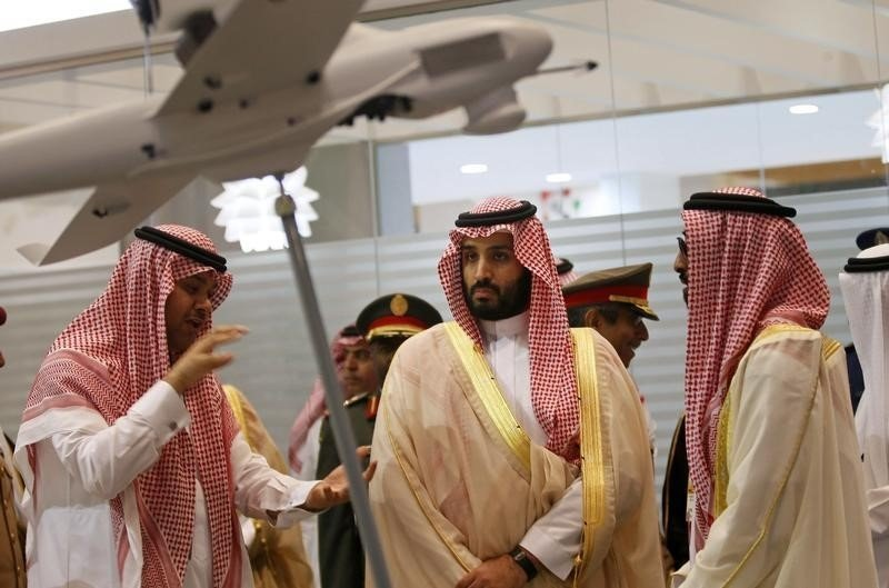 Saudi Defence Minister, Prince Mohammad bin Salman (C), visits the International Defence Exhibition and Conference (IDEX) in Abu Dhabi February 22, 2015. REUTERS/Stringer Thomson Reuters